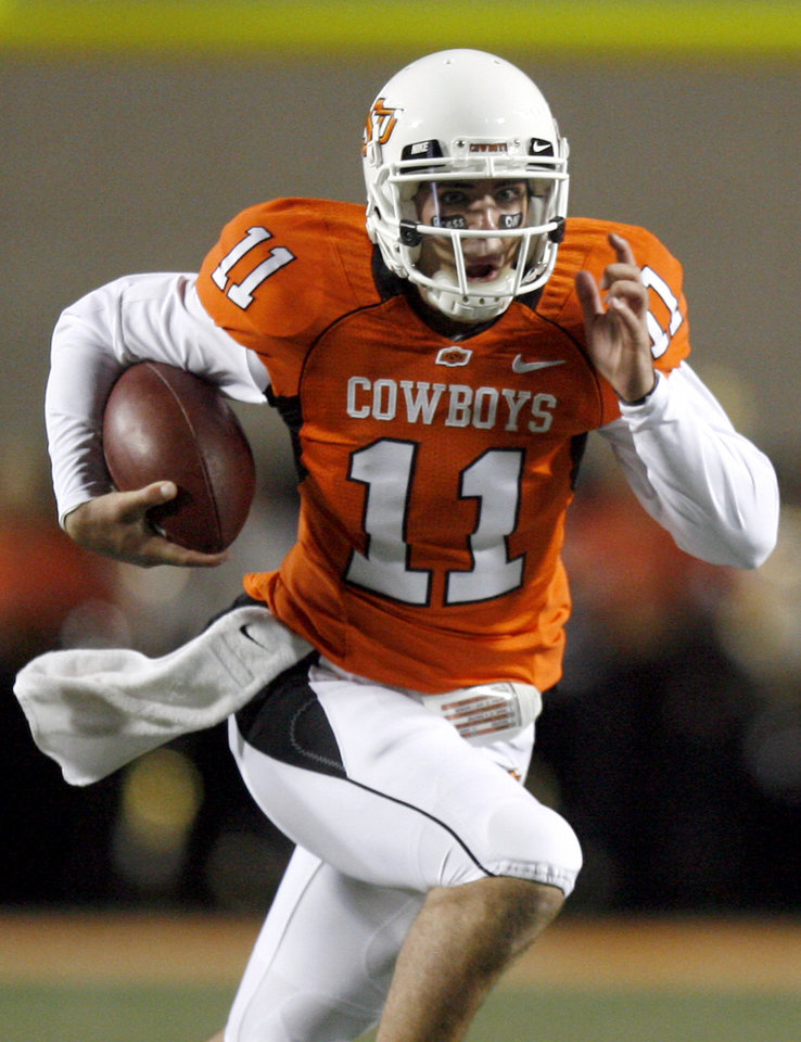 Photo - Zac Robinson and OSU would need to run the table for the Cowboys' quarterback to get an invitation to New York and the Heisman Trophy ceremony.  Photo by Sarah Phipps, The Oklahoman