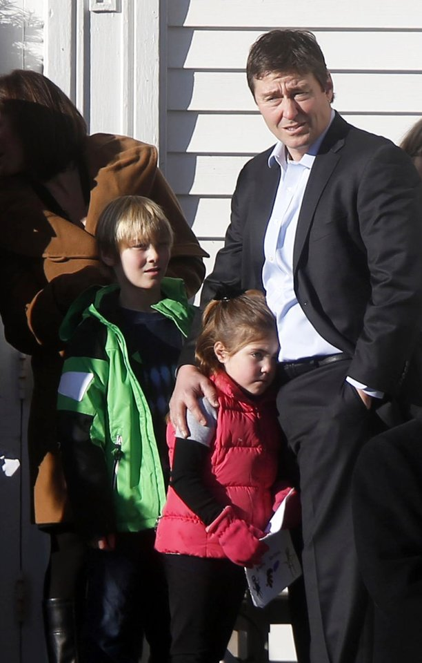 Photo - Mourners wait outside before the funeral service of Victoria Soto at Lordship Community Church, Wednesday, Dec. 19, 2012, in Stratford, Conn.  Soto was killed when a gunman forced his way into Sandy Hook Elementary School in Newtown, Dec. 14,  and opened fire, killing 26 people, including 20 children. (AP Photo/Jason DeCrow)