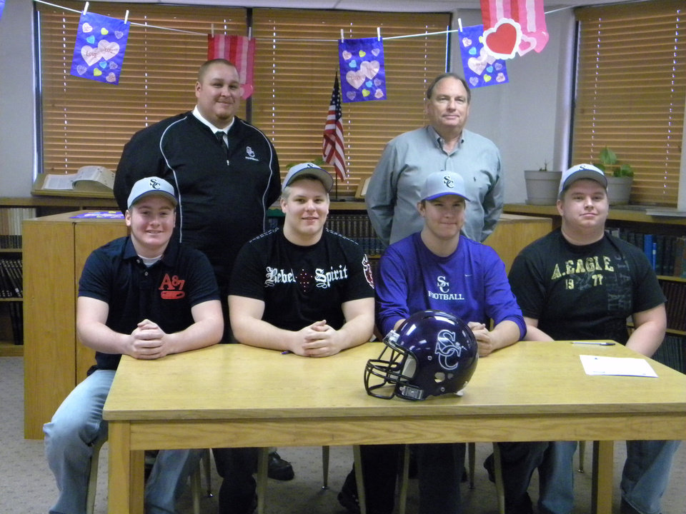 Four seniors from Seminole High school signed national letters of intent on Wednesday, Feb. 3, to play college football at Southwestern College in Winfield, Kan. Pictured are. left to right front row, Nolan Davenport, Clayton Yancy, Caleb Sullivan, and Johnny Pack. Back row is Coach Jimmie Tag (Southwestern College) and Seminole football coach Mike Synder.