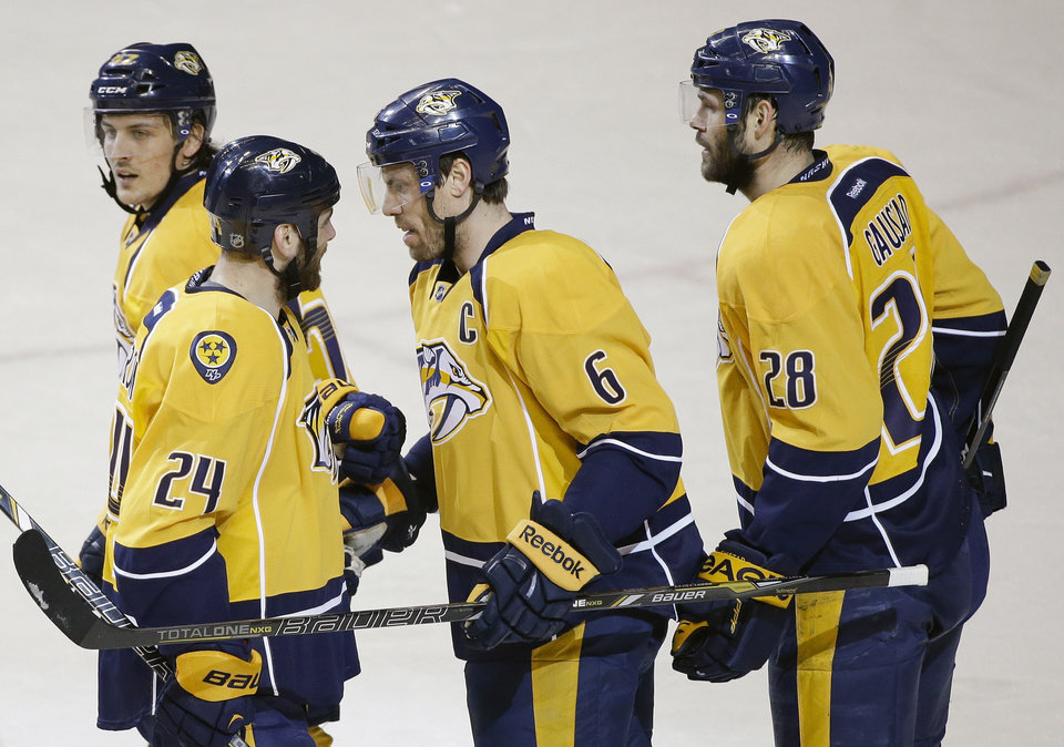 Photo - Nashville Predators defenseman Shea Weber (6) celebrates with Gabriel Bourque (57), Eric Nystrom (24) and Paul Gaustad (28) after Weber scored against the Dallas Stars in the first period of an NHL hockey game Monday, Jan. 20, 2014, in Nashville, Tenn. (AP Photo/Mark Humphrey)
