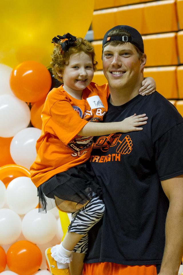 Cooper Bassett and Taylor Brandt pose for a photo. Oklahoma State University hosted a Coaches vs. Cancer Birthday party in Gallagher-Iba arena in Stillwater, Ok on Sept. 16, 2012. Photos by Mitchell Alcala for the Oklhaoman