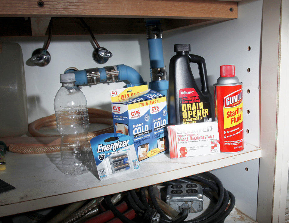 "This photo illustration shows the ingredients for a ""shake and bake"" meth lab under a sink.  Photo illustration by Doug Hoke, The Oklahoman"