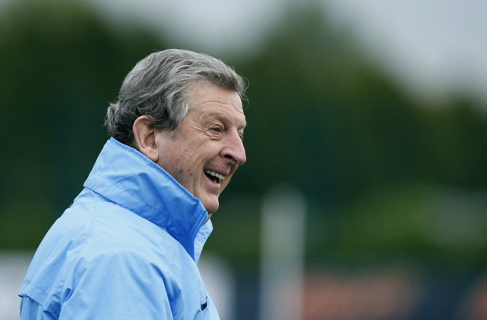 Photo - England manager Roy Hodgson arrives to supervise a training session at facilities in London Colney, Monday, Oct. 14, 2013.  England will play Poland in a World Cup Group H qualification soccer match at Wembley stadium in London on Tuesday.  (AP Photo/Matt Dunham)