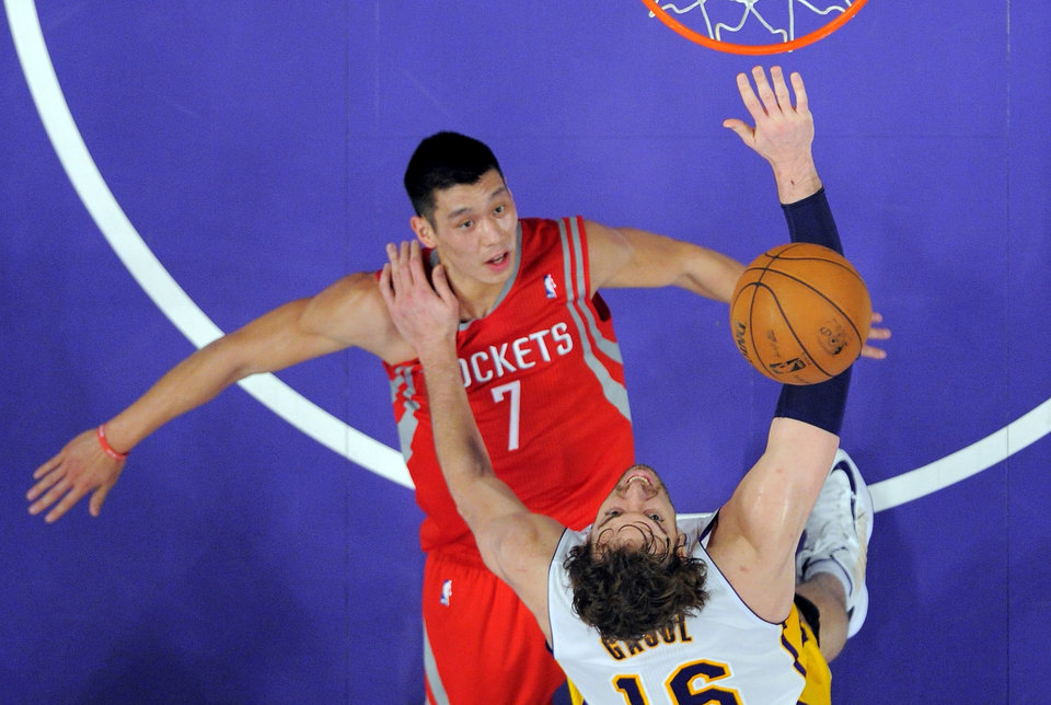 Photo -   Los Angeles Lakers forward Pau Gasol, below, of Spain, puts up a shot as Houston Rockets guard Jeremy Lin defends during the first half of their NBA basketball game, Sunday, Nov. 18, 2012, in Los Angeles. (AP Photo/Mark J. Terrill)