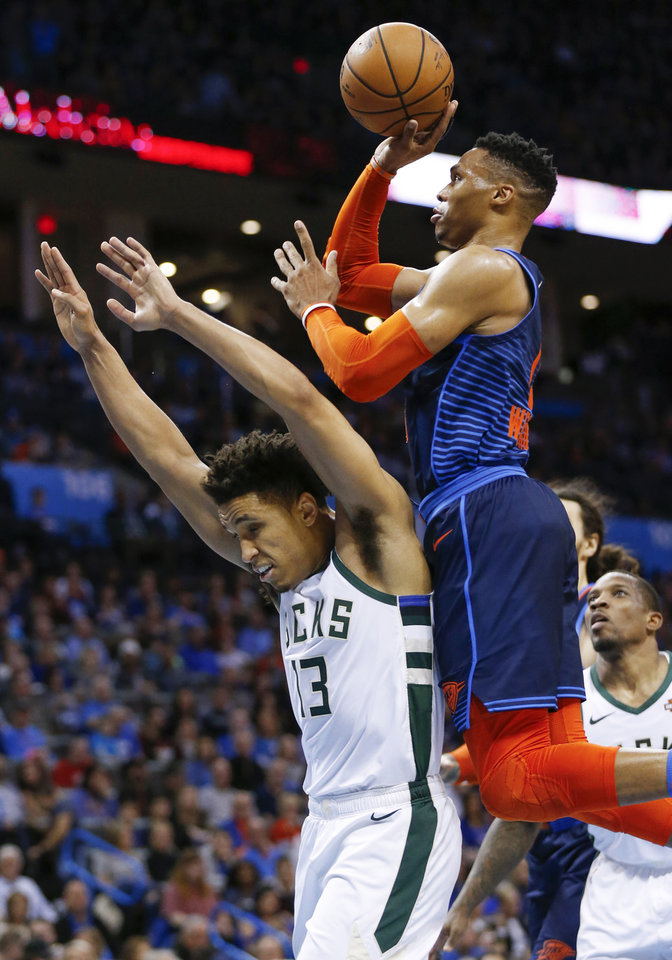 Photo - Oklahoma City's Russell Westbrook (0) shoots over Milwaukee's Malcolm Brogdon (13) in the third quarter during an NBA basketball game between the Milwaukee Bucks and the Oklahoma City Thunder at Chesapeake Energy Arena in Oklahoma City, Sunday, Jan. 27, 2019. Oklahoma City won 118-112. Photo by Nate Billings, The Oklahoman