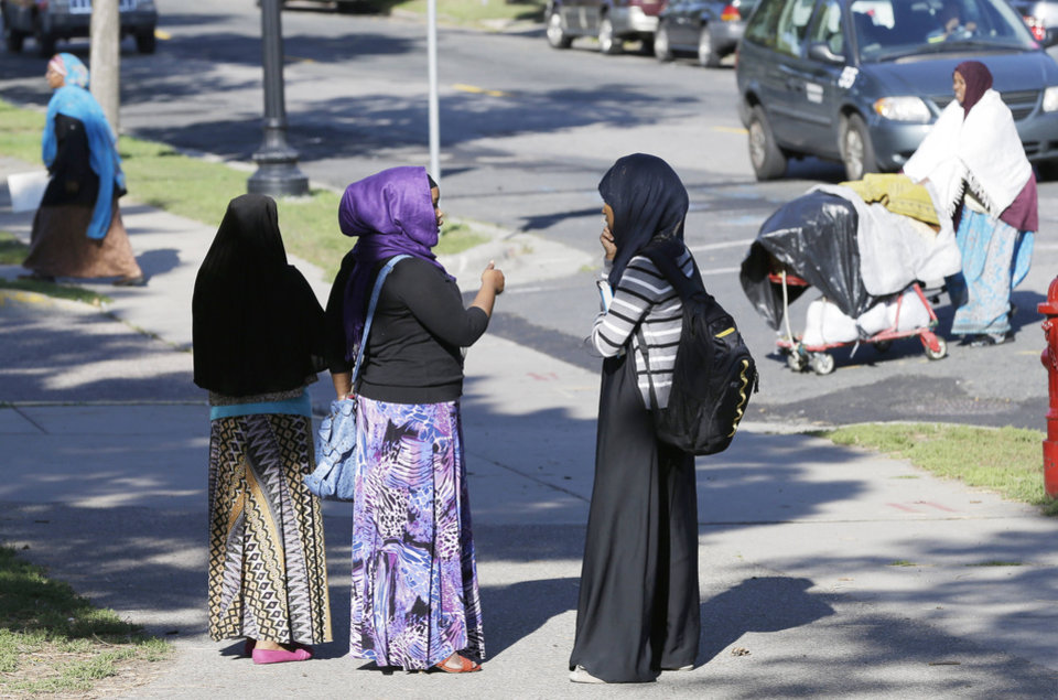 In this photo taken Tuesday, Sept. 24, 2013, members of the Somali community visit near a park in Minneapolis. It's been six years since Minnesota first began furnishing young fighters to al-Shabab, the terror group that has claimed responsibility for the deadly mall attack in Kenya. (AP Photo/Jim Mone)