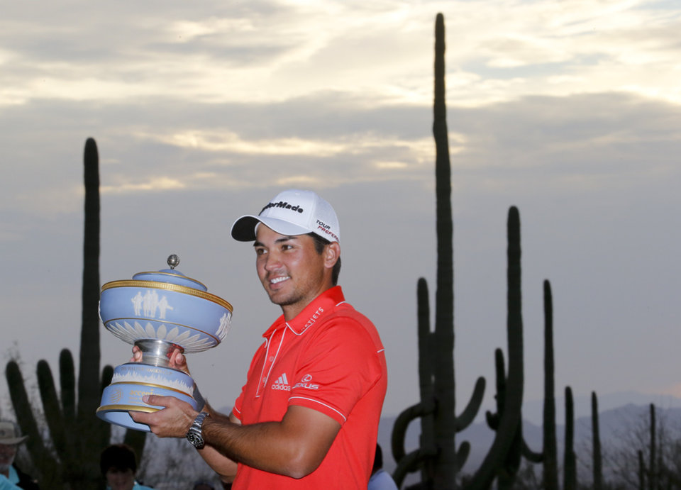 Photo - Jason Day, of  Australia, poses with the trophy after winning his championship match against Victor Dubuisson, of France, during the Match Play Championship golf tournament, Sunday, Feb. 23, 2014, in Marana, Ariz. (AP Photo/Matt York)