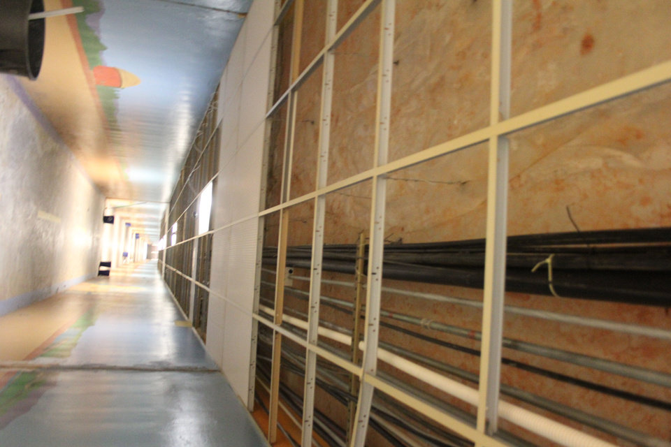 Photo - Ceiling tiles in the tunnel that leads from the east side of the state Capitol to parking lots east of N Lincoln Boulevard are being removed.