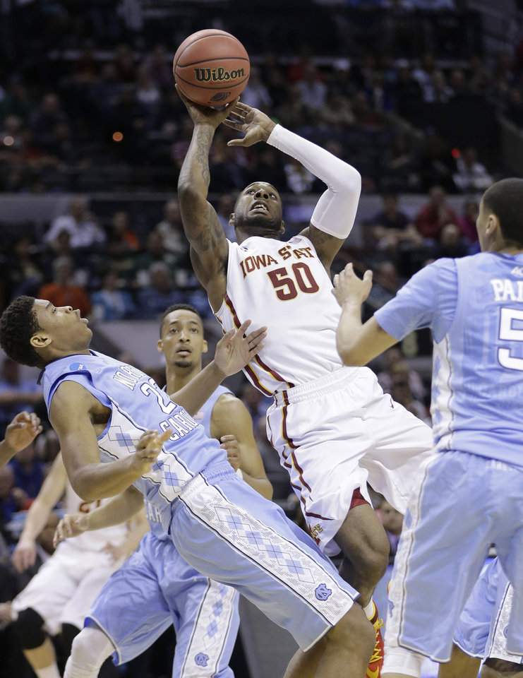 Photo - Iowa State's DeAndre Kane (50) shoots over North Carolina's Isaiah Hicks (22) during the first half of a third-round game in the NCAA college basketball tournament Sunday, March 23, 2014, in San Antonio. (AP Photo/Eric Gay)