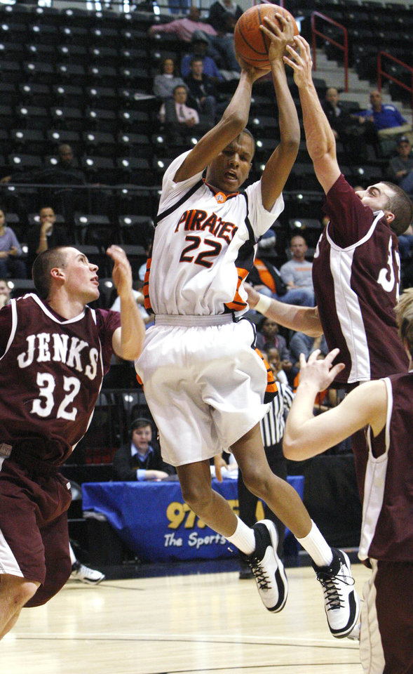 Photo - HIGH SCHOOL BASKETBALL / STATE TOURNAMENT: Putnam City's RonQuis Lewis (center) fights Jenks' Cj Sidorakis (right) for a rebound as Nick Shelbar watches.  Thursday  March 11, 2010  SHERRY BROWN/Tulsa World