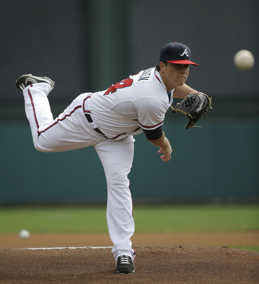 Photo - Atlanta Braves pitcher Kris Medlen throws during the first inning of an exhibition spring training baseball game against the Miami Marlins Monday, Feb. 25, 2013, in Kissimmee, Fla. (AP Photo/David J. Phillip)