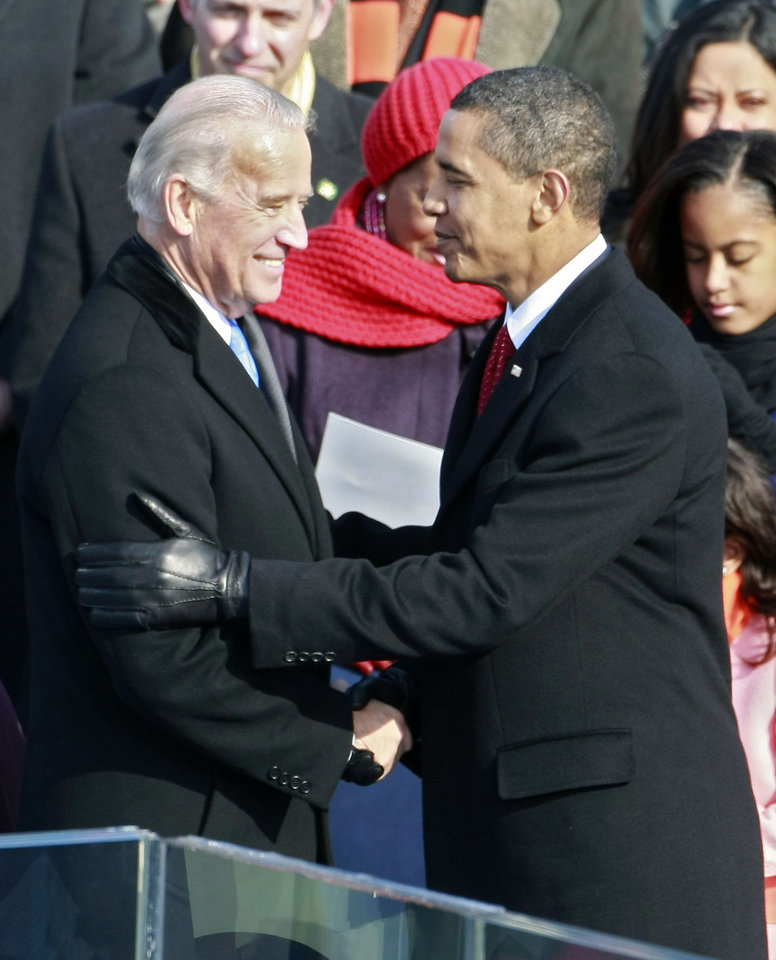 Photo - Vice President Joseph R. Biden is greeted by President-elect Barack Obama after being sworn in during the inauguration of Barack Obama as the 44th President of the United States of America on the West Front of the Capitol Tuesday, Jan. 20, 2009 in Washington.   (AP Photo/Mark Wilson, Pool)