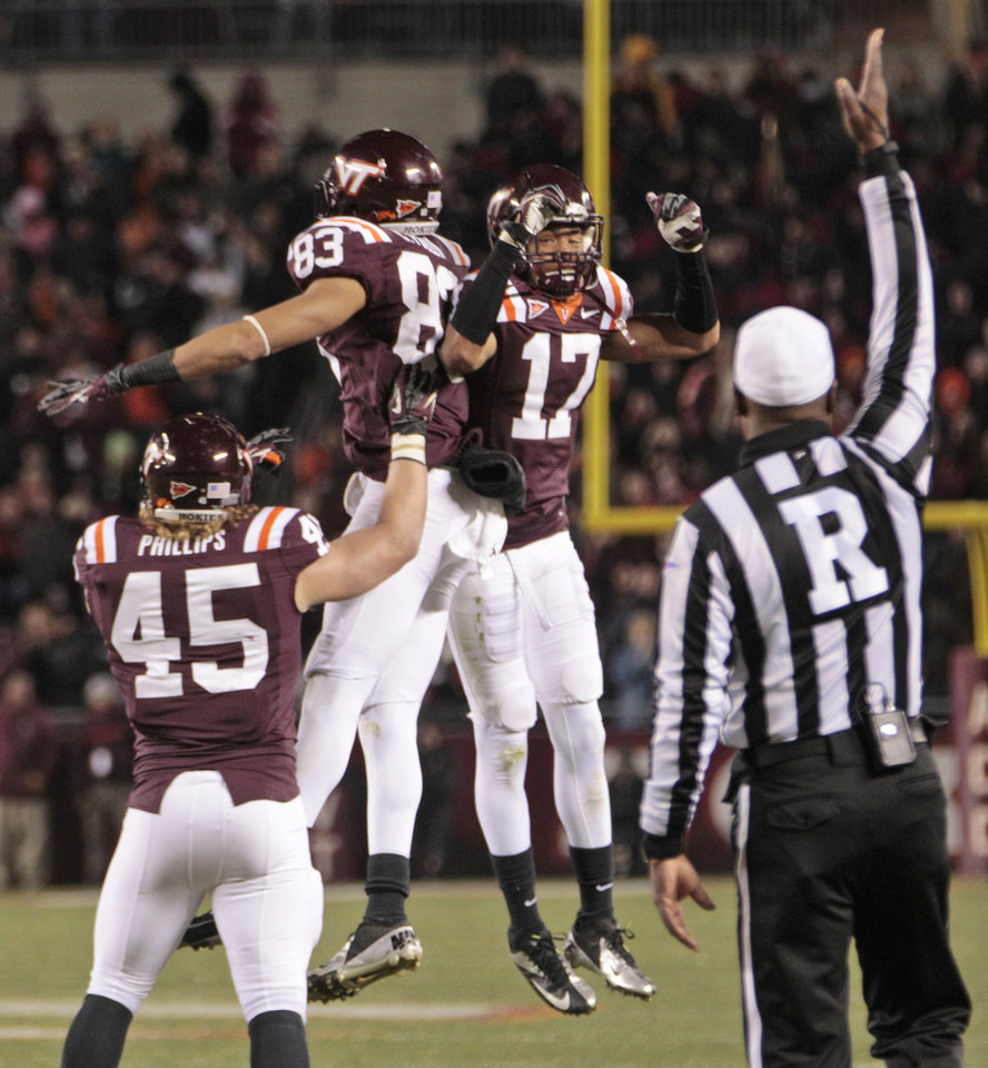 Photo -   Virginia Tech wide receiver Corey Fuller (83) celebrates a touchdown with cornerback Kyle Fuller (17) and fullback Joey Phillips (45) during the first half of an NCAA college football game against Florida State in Blacksburg, Va., Thursday, Nov. 8, 2012. (AP Photo/Steve Helber)