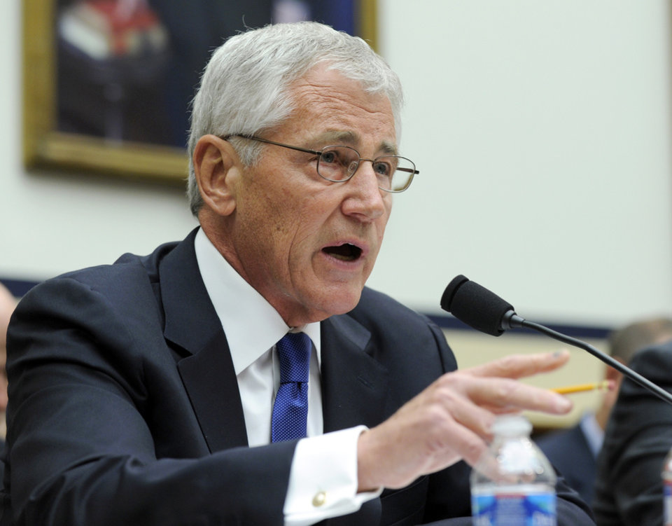 Photo - Defense Secretary Chuck Hagel testifies on Capitol Hill in Washington, Wednesday, June 11, 2014, before the House Armed Services Committee. Hagel faced angry lawmakers becoming the first Obama administration official to testify publicly about the controversial prisoner swap with the Taliban. (AP Photo/Susan Walsh)