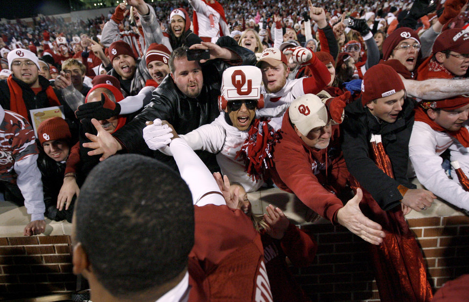 Photo - Fans celebrate with R.J. Washington after the college football game between the University of Oklahoma Sooners and Texas Tech University at Gaylord Family -- Oklahoma Memorial Stadium in Norman, Okla., Saturday, Nov. 22, 2008. BY BRYAN TERRY, THE OKLAHOMAN
