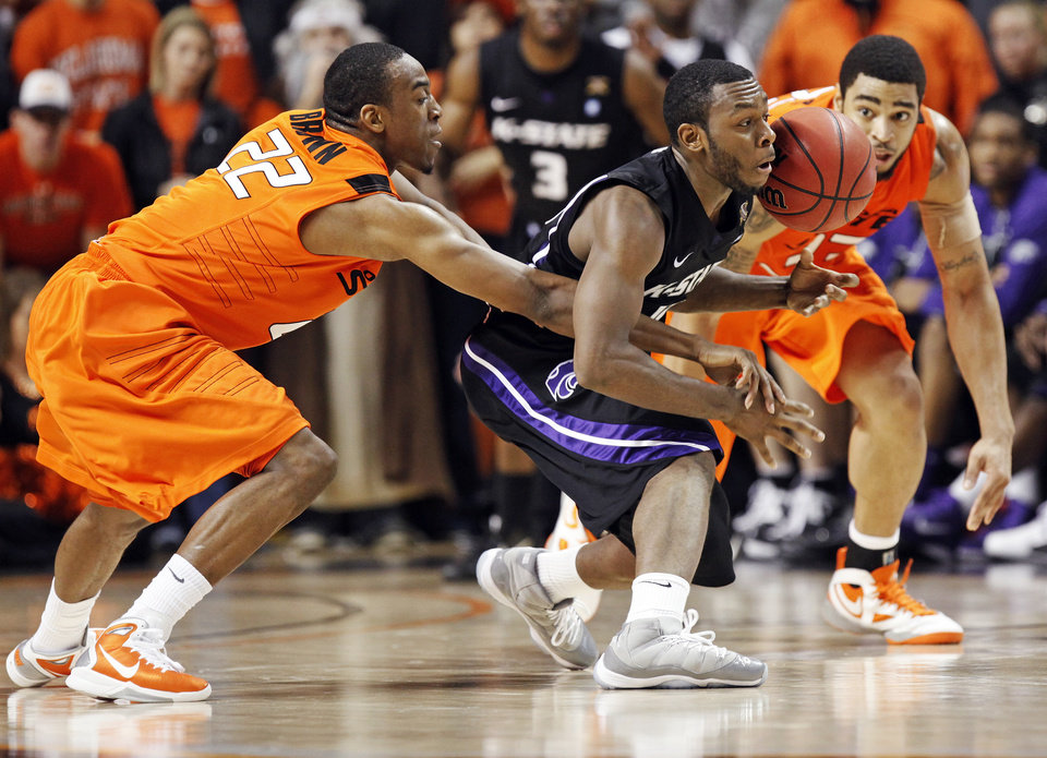 Photo - OSU's Markel Brown (22) tries to knock the ball away from Jacob Pullen (0) of KSU in front of OSU's Marshall Moses (33) during the men's college basketball game between Oklahoma State University (OSU) and Kansas State University (KSU) at Gallagher-Iba Arena in Stillwater, Okla., Saturday, January 8, 2011. OSU won, 76-62. Photo by Nate Billings, The Oklahoman