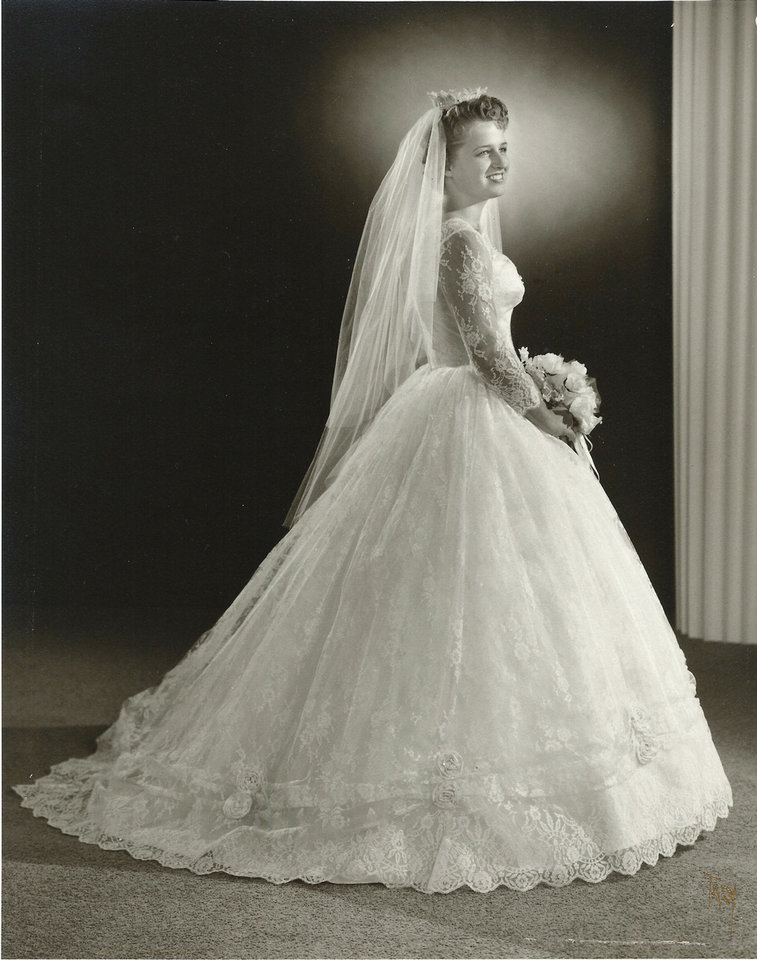 Photo - After five years of dating, Nancy Richardson Canterberry married her high school sweetheart, Richard, on Oct. 3, 1959. She was overjoyed to walk down the aisle in her beautiful dress, said Julie Stanfill, her daughter. Her lace-covered dress was modest, with a small waist to hold the puffed skirt, a popular style for the '50s, resembling the skirt and train worn by Grace Kelly.  Photo provided by Julie Stanfill - Photo provided by Julie Stanfil