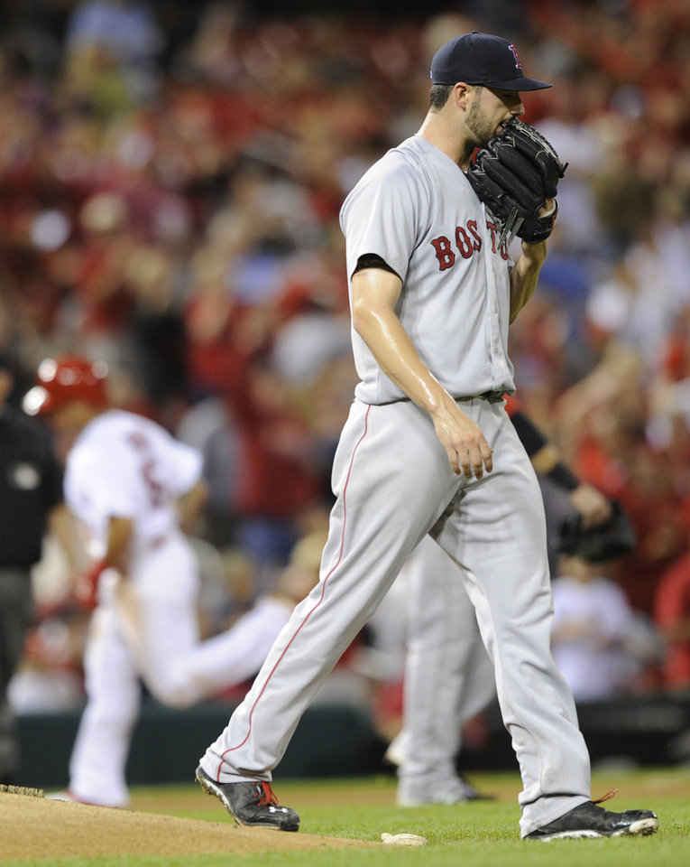 Photo - Boston Red Sox's starting pitcher Brandon Workman, right, walks off the mound after giving up a solo home run to St. Louis Cardinals' Kolton Wong, rear, in the fifth inning in a baseball game, Thursday, August 7, 2014, at Busch Stadium in St. Louis. (AP Photo/Bill Boyce)