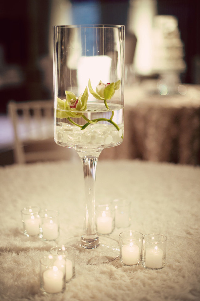 Photo - Use simple centerpieces to save on flowers. Photo by Traina Photography.