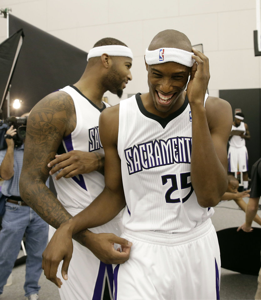 Photo - Sacramento Kings center DeMarcus Cousins, left, jokes with teammate Travis Outlaw during the team's NBA basketball media day in Sacramento, Calif., Monday, Sept. 30, 2013. (AP Photo/Rich Pedroncelli)