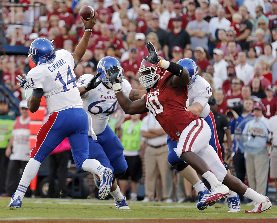 OU\'s David King (90) puts pressure on KU\'s Michael Cummings (14) during the college football game between the University of Oklahoma Sooners (OU) and the University of Kansas Jayhawks (KU) at Gaylord Family-Oklahoma Memorial Stadium on Saturday, Oct. 20th, 2012, in Norman, Okla. Photo by Chris Landsberger, The Oklahoman