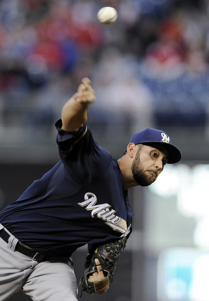 Photo - Milwaukee Brewers starting pitcher Marco Estrada delivers a pitch in the first inning of a baseball game against the Philadelphia Phillies on Thursday, April 10, 2014, in Philadelphia. (AP Photo/Michael Perez)