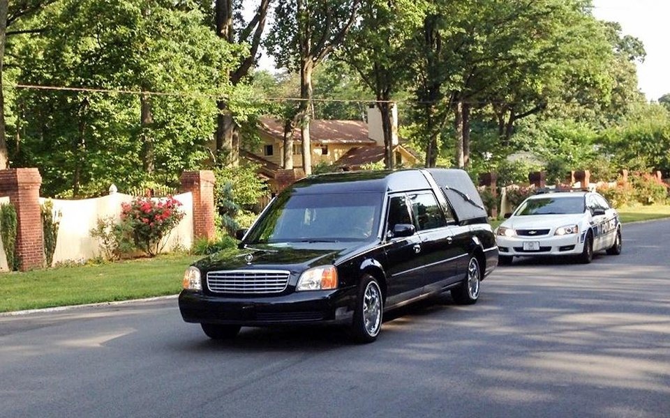 Photo - In this image made with a cell phone camera, a hearse with a police escort leaves the Winston-Salem, N.C., home of Maya Angelou, Wednesday, May 28, 2014. Angelou, who rose from poverty, segregation and violence to become a force on stage, screen and the printed page, has died, Wake Forest University said Wednesday, May 28, 2014.  She was 86. (AP Photo/ Winston-Salem Journal, Lisa O'Donnell) MANDATORY CREDIT