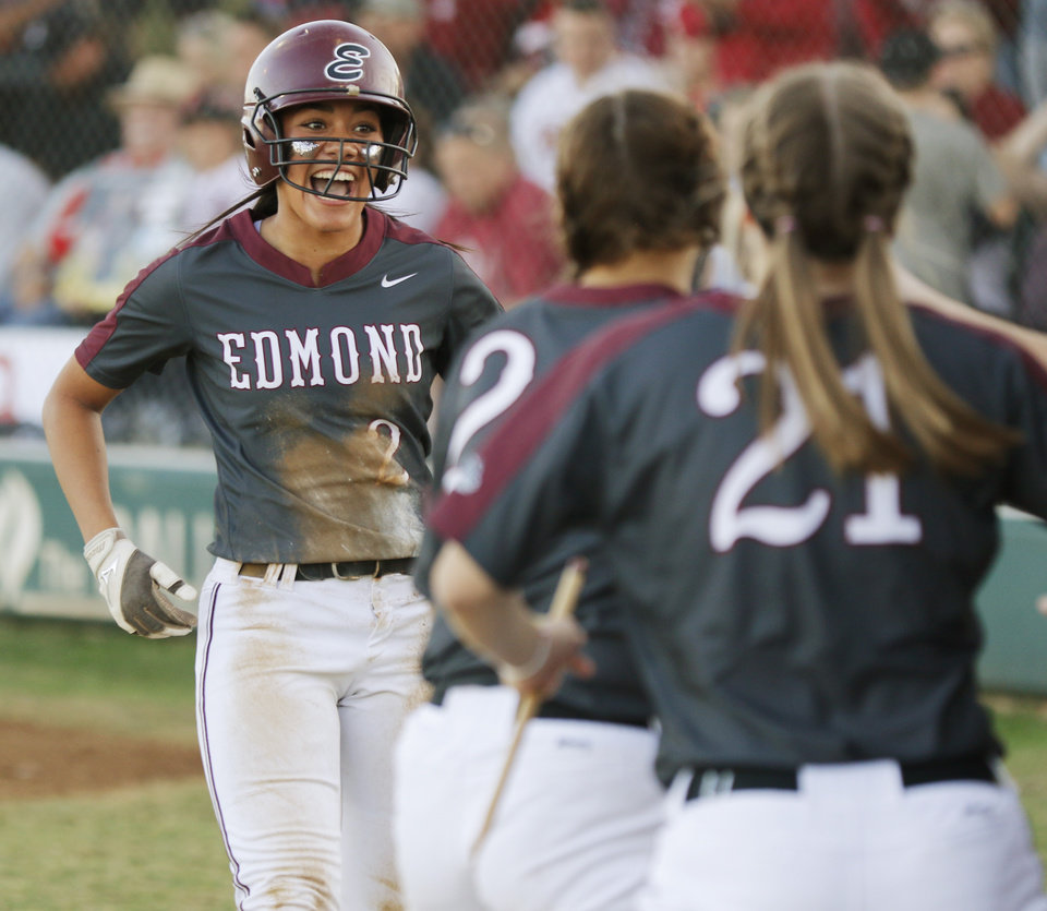 Photo - EHS #2 Caylor Cole comes to dugout after scoring during the 6A Fast Pitch Championship game between Edmond Memorial and Owasso at the Ball Fields at Firelake in Shawnee, Saturday, October 19, 2019. [Doug Hoke/The Oklahoman]