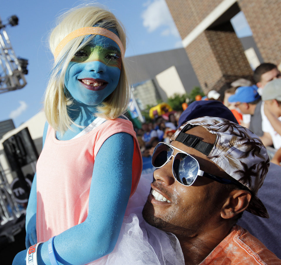 Photo - Thunder fan Hannah Peevy, 6, of Oklahoma City, smiles with her father, William Peevy, outside the arena before Game 6 of the Western Conference Finals in the NBA playoffs between the Oklahoma City Thunder and the San Antonio Spurs at Chesapeake Energy Arena in Oklahoma City, Saturday, May 31, 2014. Photo by Nate Billings, The Oklahoman