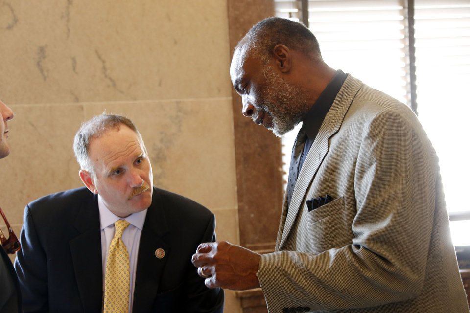 Photo - Reps. Mark Baker, R-Madison, left, and James Evans, D-Jackson, confer during a break in the Special Session at the Capitol in Jackson, Miss., Thursday June 27, 2013, Lawmakers are dealing with the reauthorization and budgeting of Medicaid. Medicaid is a government health insurance program for the needy, and it covers about 644,000 of the state's nearly 3 million residents. (AP Photo/Rogelio V. Solis)