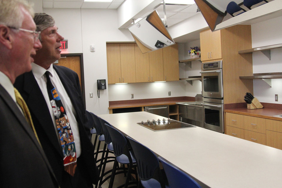 Gary Cox, director of the Oklahoma City-County Health Department, and Dr. Stephen Cagle, chairman of the Oklahoma City-County Health Department's board, discuss the kitchen area in the Northeast Regional Health and Wellness Campus. Health department workers will use the kitchen to teach residents about healthy cooking options. <strong>Jaclyn Cosgrove - Staff Writer</strong>