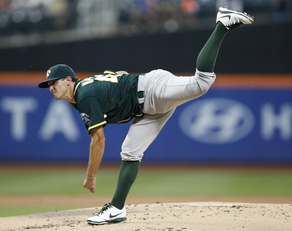 Photo - Oakland Athletics Brad Mills follows through in the first inning of an interleague baseball game against the New York Mets in New York, Wednesday, June 25, 2014. (AP Photo/Kathy Willens)