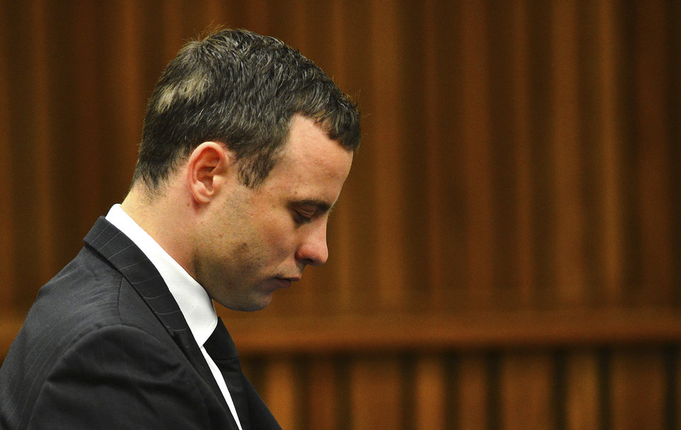 Photo - Oscar Pistorius listens to evidence in court in Pretoria, South Africa, June 30, 2014. The murder trial of Pistorius resumed Monday, after one month during which mental health experts evaluated the athlete to determine if he has an anxiety disorder that could have influenced his actions on the night he killed his girlfriend Reeva Steenkamp. (AP Photo/Phill Magakoe, Pool)