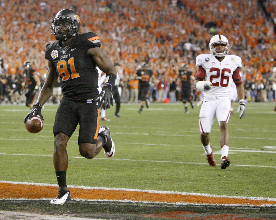 Oklahoma State\'s Justin Blackmon (81) scores a touchdown in front of Delano Howell (26) during the Fiesta Bowl between the Oklahoma State University Cowboys (OSU) and the Stanford Cardinal at the University of Phoenix Stadium in Glendale, Ariz., Monday, Jan. 2, 2012. Photo by Bryan Terry, The Oklahoman