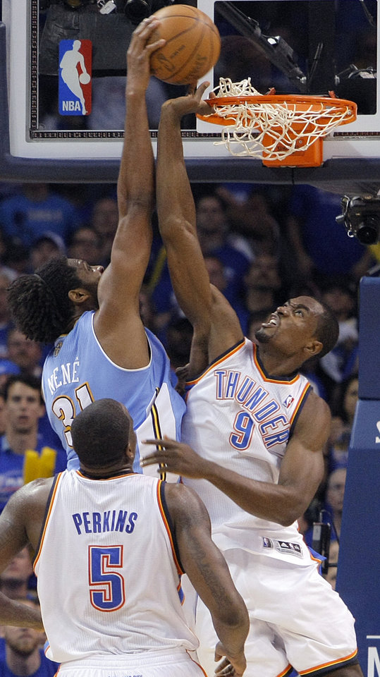 Photo - Oklahoma City's Serge Ibaka (9) defends the basket against Denver's Nene (31) during the first round NBA playoff game between the Oklahoma City Thunder and the Denver Nuggets on Sunday, April 17, 2011, in Oklahoma City, Okla. Photo by Chris Landsberger, The Oklahoman