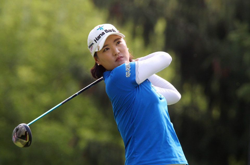 Photo - So Yeon Ryu, of South Korea, watches her tee shot on the 14th hole at the Canadian Pacific Women's Open golf tournament in London, Ontario, Thursday, Aug. 21, 2014. (AP Photo/The Canadian Press, Dave Chidley)