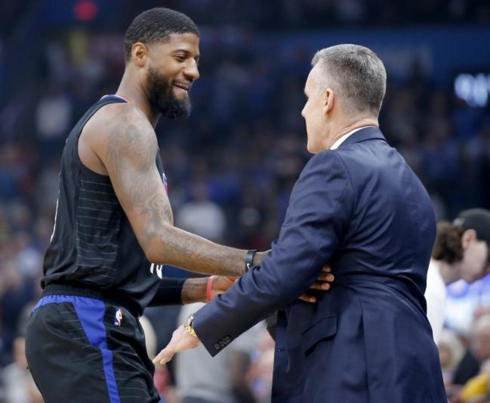 Photo -  Los Angeles Clippers star and former Thunder standout Paul George, left, talks with Oklahoma City coach Billy Donovan before Tuesday night's game at Chesapeake Energy Arena. The Clippers beat OKC 109-94. [Bryan Terry/The Oklahoman]