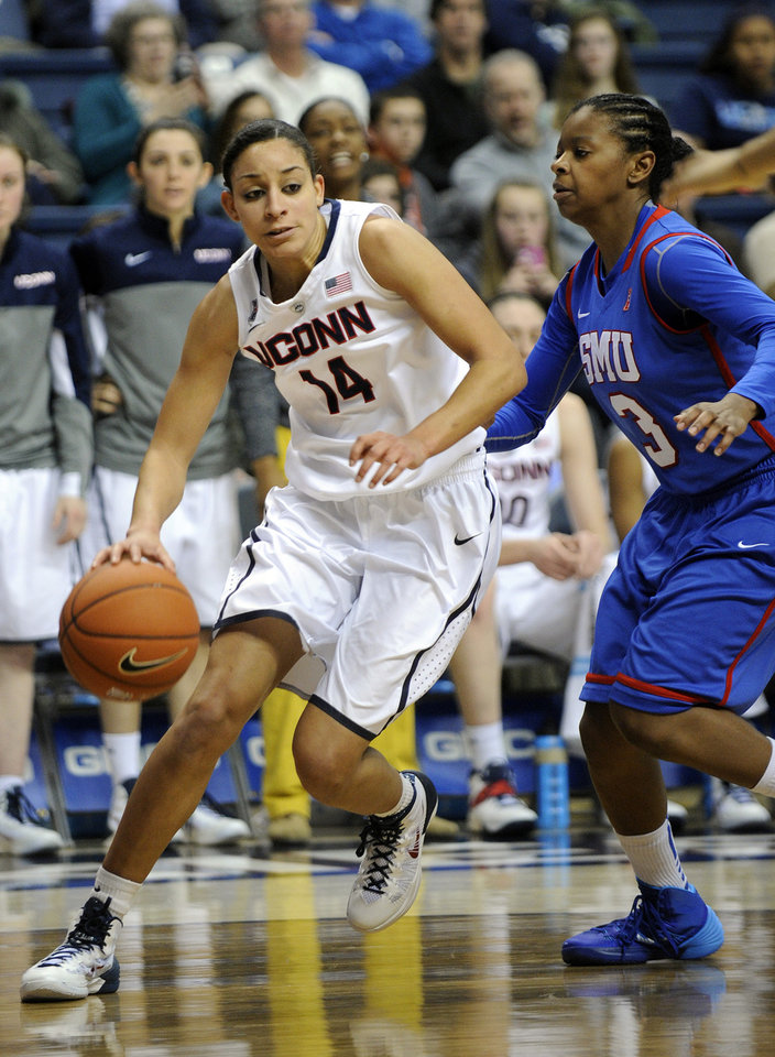 Connecticut's Bria Hartley (14) drives past SMU's Gabrielle Wilkins (3) during the second half of an NCAA college basketball game in Storrs, Conn., Tuesday, Feb. 4, 2014. Hartley scored a game-high 21 points in her team's 102-41 victory. (AP Photo/Fred Beckham)
