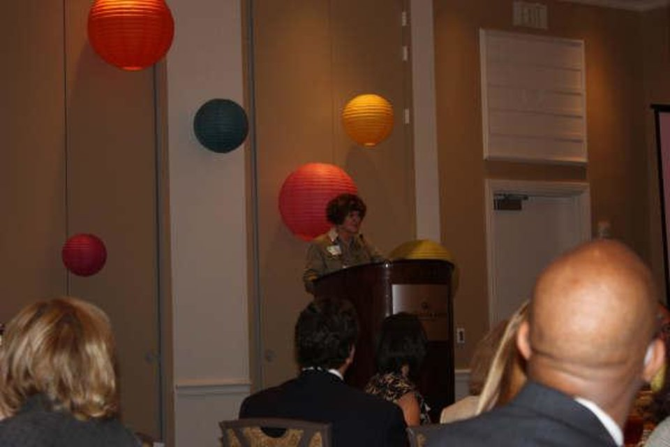 AWARD LUNCHEON....Pat Schonwald talks after being named Junior League Sustainer of the Year. (Photo by Vonne Hanke.)