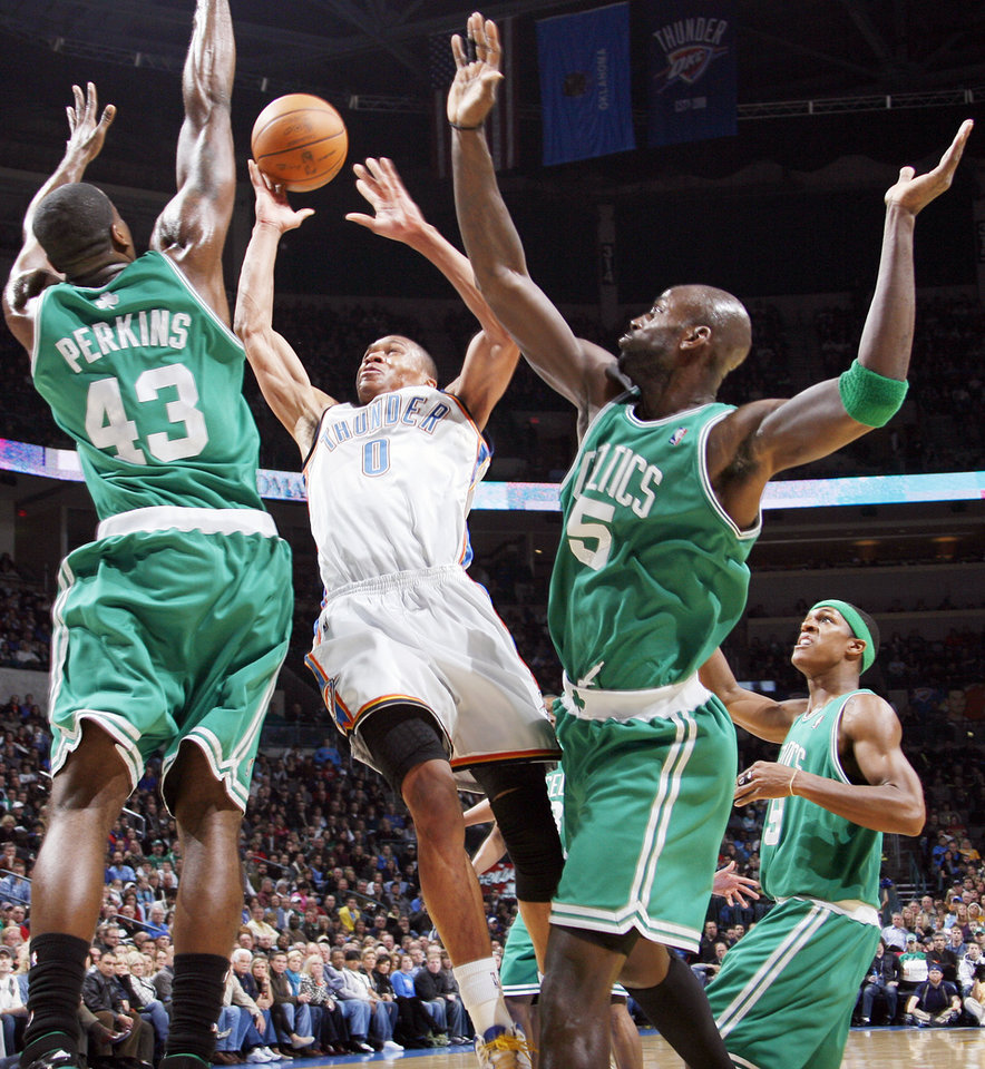 Photo - Oklahoma City's Russell Westbrook, center, takes a shot between Boston's Kendrick Perkins, left, and Kevin Garnett, second from right, as Rajon Rondo looks on in the first half Friday. Photo by Nate Billings, The Oklahoman