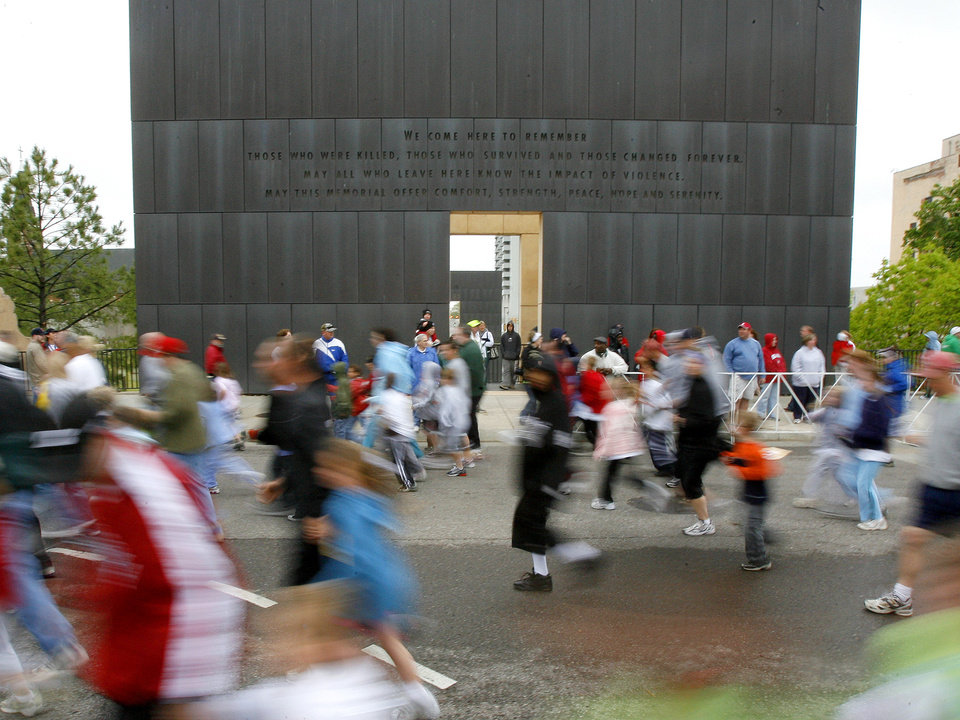 Photo - RUN, RUNNER, RUNNING, CHILDREN: Participants in the kids marathon race past the Oklahoma City National Memorial during the Oklahoma City Memorial Marathon, Sunday, April 27, 2008.  BY BRYAN TERRY, THE OKLAHOMAN ORG XMIT: KOD