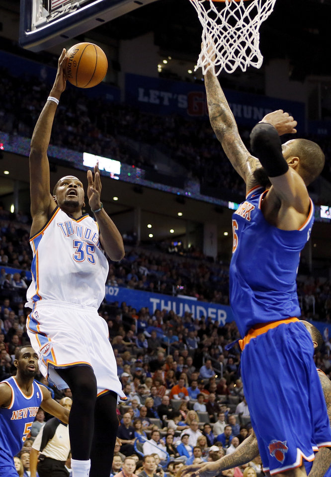 Oklahoma City's Kevin Durant (35) shoots against New York's Tyson Chandler (6) during an NBA basketball game between the New York Knicks and the Oklahoma City Thunder at Chesapeake Energy Arena in Oklahoma City, Sunday, Feb. 9, 2014. Photo by Nate Billings, The Oklahoman