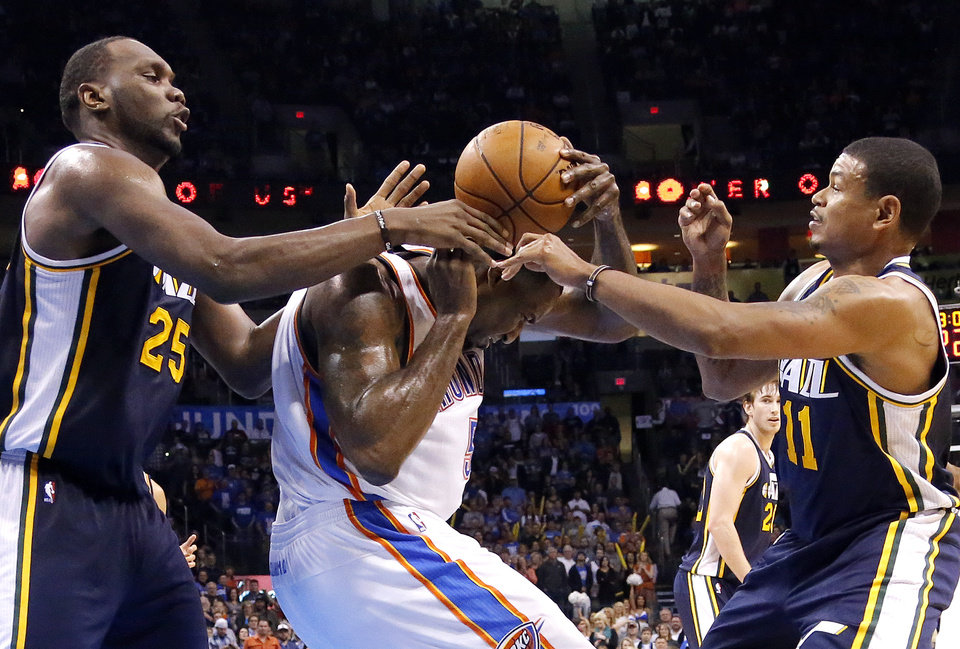 Oklahoma City's Kevin Durant (35) tries to gain control of a ball from Utah's Al Jefferson (25) and Earl Watson (11) during the NBA game between the Oklahoma City and the Utah Jazz and the Chesapeake Energy Arena, Friday,Nov. 30, 2012. Photo by Sarah Phipps, The Oklahoman