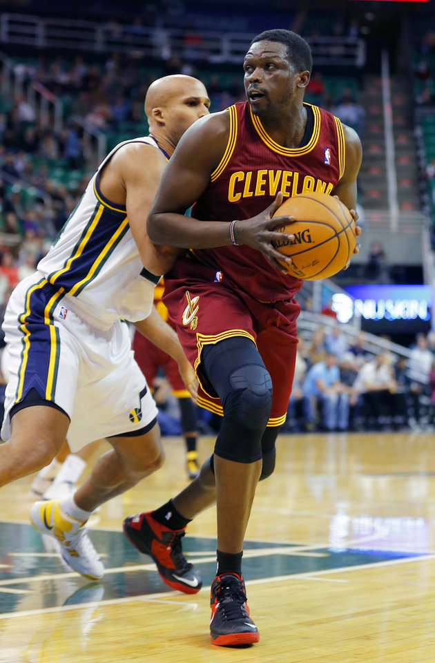 Photo - Cleveland Cavalier's Luol Deng, right, looks to shoot over Utah Jazz's Richard Jefferson during an NBA basketball game in Salt Lake City, Friday, Jan. 10, 2014. (AP Photo/George Frey)