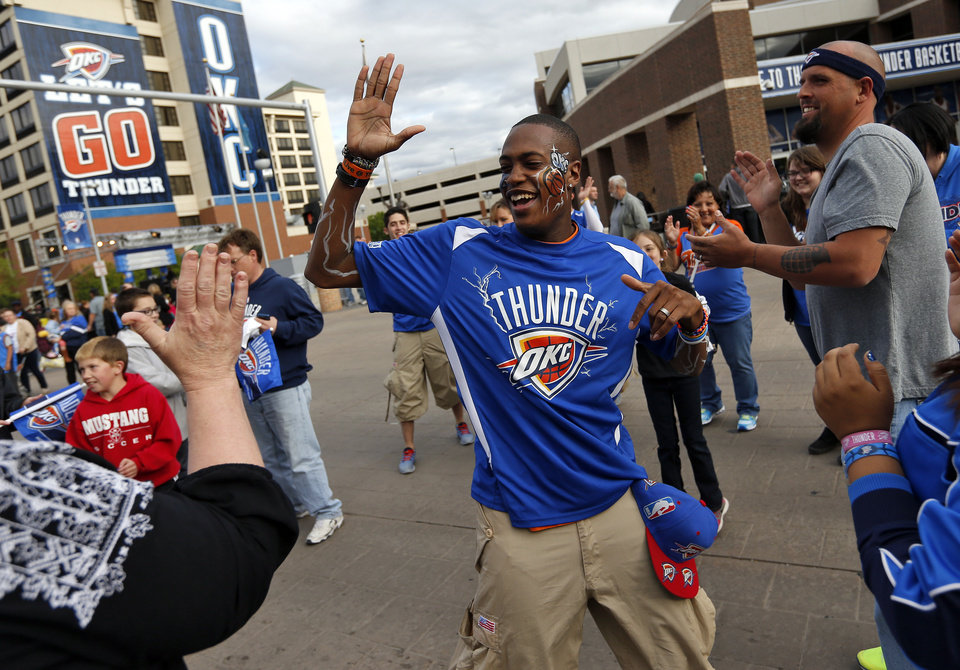 Photo - Justin Williams, a member of the Storm Chasers, dances with fans in Thunder Alley before Game 5 in the first round of the NBA playoffs between the Oklahoma City Thunder and the Memphis Grizzlies at Chesapeake Energy Arena in Oklahoma City, Tuesday, April 29, 2014. Photo by Nate Billings, The Oklahoman