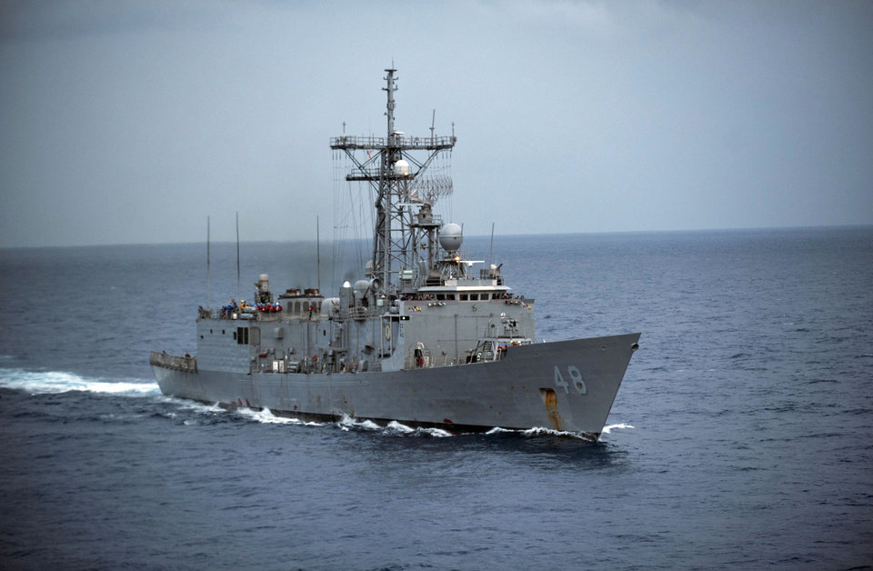 Photo - In this image provided by the U.S. Navy the USS Vandegrift is underway Oct. 15, 2012 in the South China Sea. The U.S. Navy warship reached the crippled sailboat hundreds of miles off the Mexican coast and was preparing Sunday April 6, 2014 to complete the rescue of a sick 1-year-old girl. (AP Photo/U.S. Navy, Specialist 3rd Class Paul Kelly)