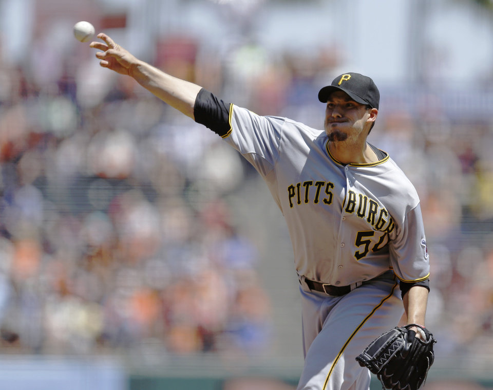 Photo - Pittsburgh Pirates' Charlie Morton works against the San Francisco Giants in the first inning of a baseball game Wednesday, July 30, 2014, in San Francisco. (AP Photo/Ben Margot)