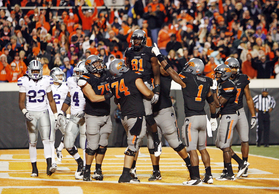 Photo - The OSU Cowboys celebrate a catch for a two-point conversion by Justin Blackmon (81) in the fourth quarter during a college football game between the Oklahoma State University Cowboys (OSU) and the Kansas State University Wildcats (KSU) at Boone Pickens Stadium in Stillwater, Okla., Saturday, Nov. 5, 2011. OSU won, 52-45. Photo by Nate Billings, The Oklahoman