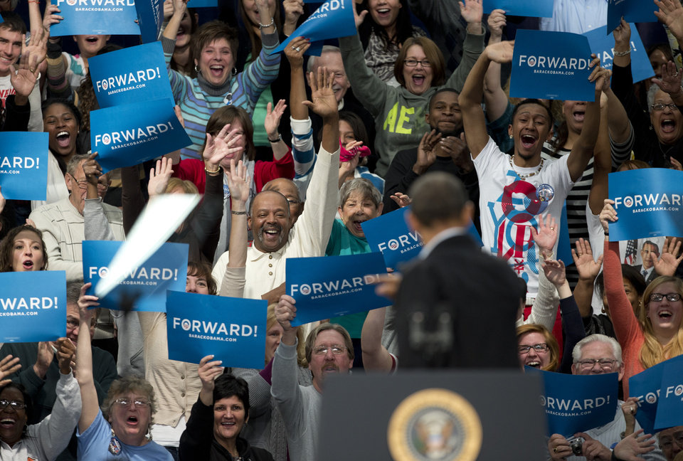 Photo -   Supporters cheer as President Barack Obama turns to greets them as he arrives on stage at a campaign event at Springfield High School, Friday, Nov. 2, 2012, in Springfield, Ohio, before heading to another campaign stop in Lima, Ohio. (AP Photo/Carolyn Kaster)