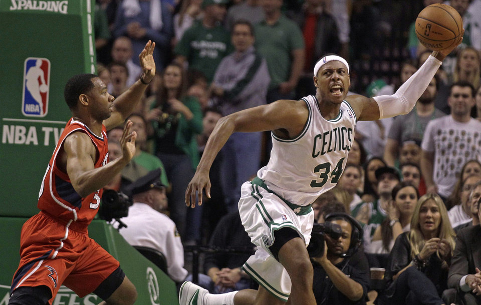 Photo -   Boston Celtics' Paul Pierce (34) looks to pass as he is chased by Atlanta Hawks' Willie Green (33) during Game 3 of an NBA first-round playoff basketball series, Friday, May 4, 2012, in Boston. The Celtics defeated the Hawks 90-84, leading the series 2-1. (AP Photo/Charles Krupa)